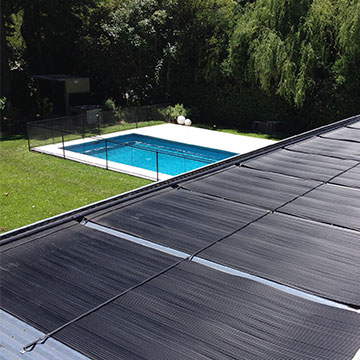 Ecosun solar pool heater installed on roof of residential home